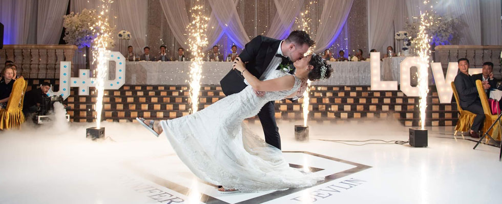 Bride and groom kissing with special effects of sparkling pyrotechnics